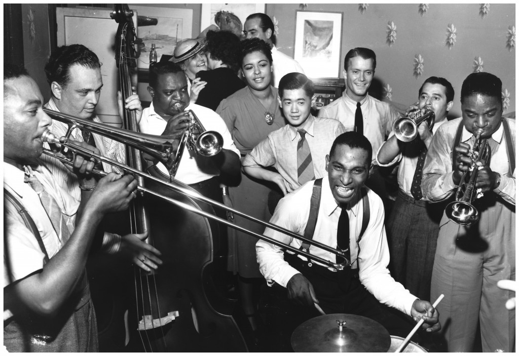 cozy-cole-on-drums-jc-higghinbotam-clyde-newcombe-rex-stewart-billie-holliday-harry-lim-eddie-condon-gown-brad-lipps-page
