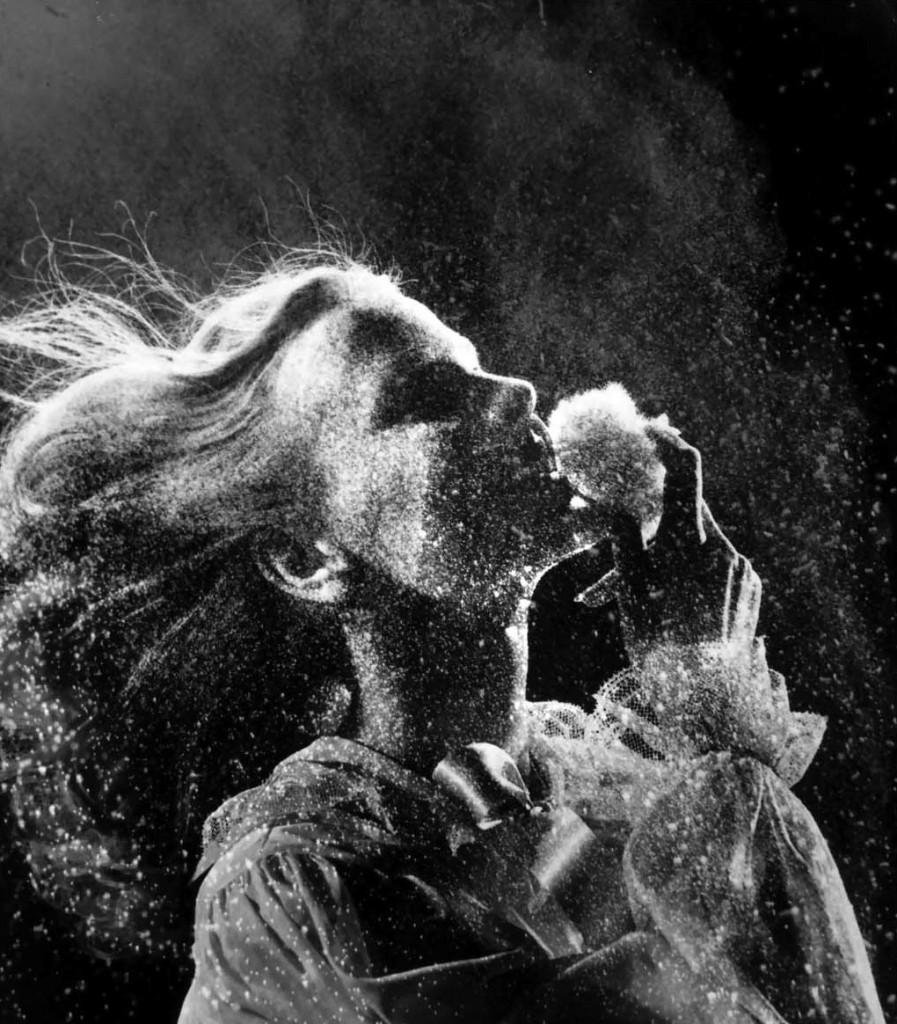 woman-using-powder-puff-as-clouds-of-powder-float-around-her-head-1943-gjon-mili